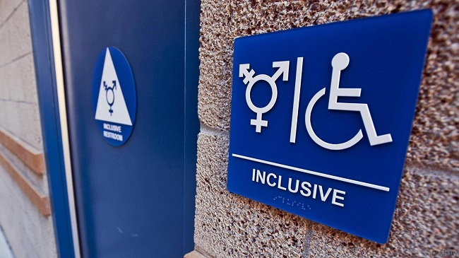 Irvine, California, USA. 15th Feb, 2015. The University of California at Irvine campus has designated nearly two dozen public bathrooms as gender neutral using signage with ''Inclusive Restroom, '' written out in white letters below a white triangle featu